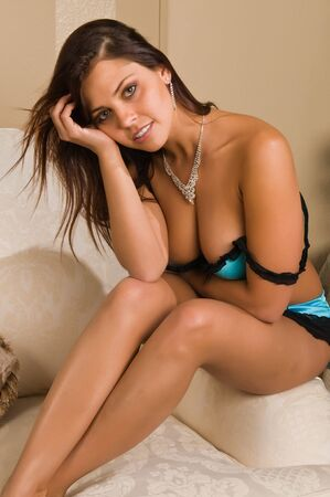 blue lingerie: Pretty young brunette dressed in turquoise lingerie Stock Photo