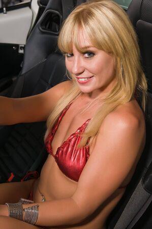 shiny car: Beautiful tall blonde in a sports car Stock Photo