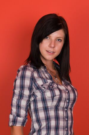 Pretty slender brunette in a western plaid shirt 版權商用圖片