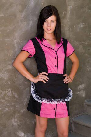 Pretty slender brunette in a retro waitress uniform photo