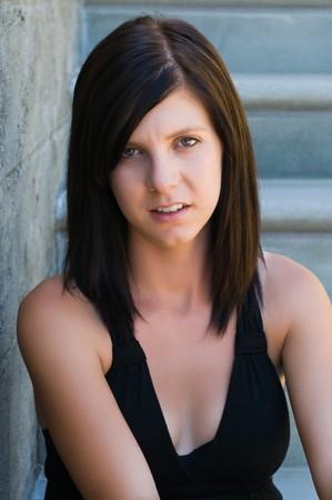 Pretty slender brunette in a black dress
