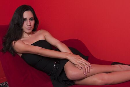 Beautiful young Latina in a black strapless dress photo
