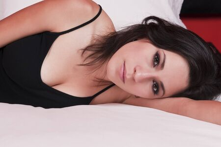 recline: Beautiful young Latina in a black top