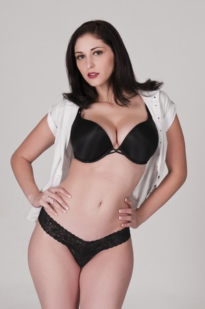 Beautiful brunette in white blouse and black lingerie photo