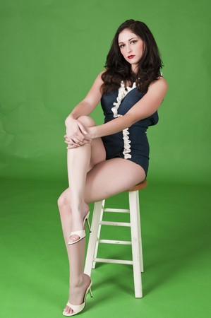 stool: Beautiful brunette in a vintage one-piece swimsuit