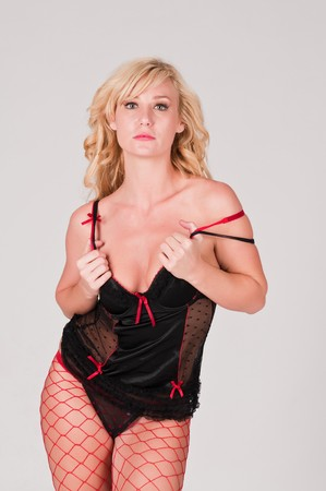 Beautiful tall blonde in black and red lingerie