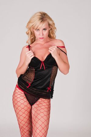 undergarment: Beautiful tall blonde in black and red lingerie