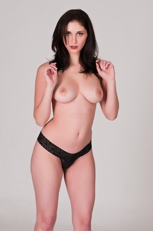 topless brunette: Beautiful young topless brunette in black panties Stock Photo