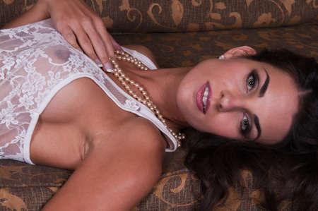 Beautiful young Czech woman lying down in sheer white lingerie