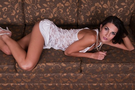 couches: Beautiful young Czech woman lying down in sheer white lingerie