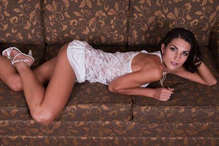 sheer lingerie: Beautiful young Czech woman lying down in sheer white lingerie