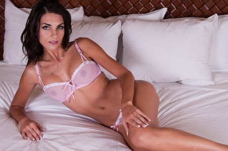 Beautiful young Czech woman in sheer pink lingerie Stock Photo - 8214571