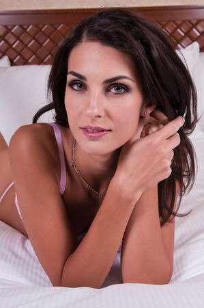 Beautiful young Czech woman in sheer pink lingerie photo
