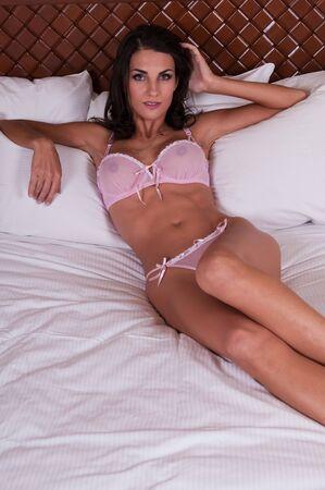 sheer lingerie: Beautiful young Czech woman in sheer pink lingerie Stock Photo