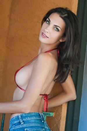 Beautiful young Czech woman in a skimpy bikini top photo