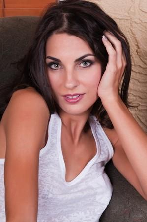 Beautiful young Czech woman in an armchair 免版税图像