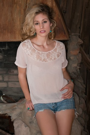 blacksmith shop: Beautiful blonde in an Old West blacksmith shop Stock Photo