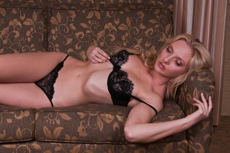 undergarment: Beautiful tall blonde dressed in black lingerie