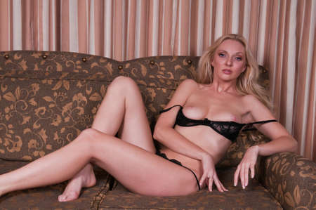 Beautiful tall blonde dressed in black lingerie Stock Photo - 8214699
