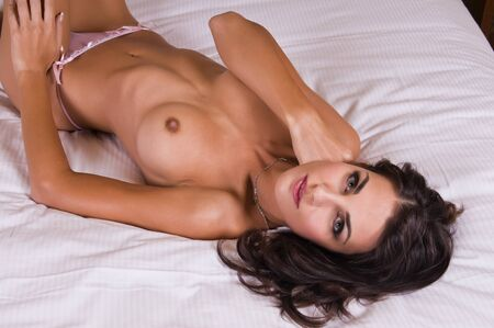 Beautiful young Czech woman lying topless in bed Stock Photo - 8290771
