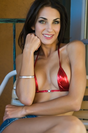 Beautiful young Czech woman in a skimpy bikini top photo