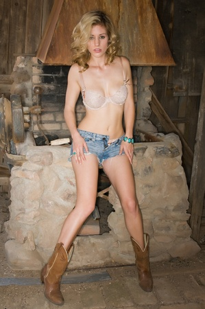 smithy: Pretty young blonde in a cream colored bra and jeans shorts