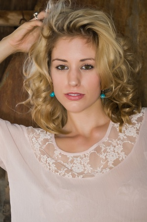 Pretty young blonde in a cream colored blouse photo