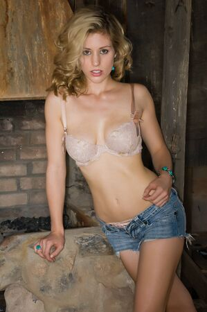 forge: Pretty young blonde in a cream colored bra and jeans shorts