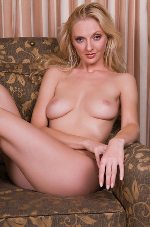 Beautiful statuesque blonde lying nude on a sofa Stock Photo - 8290988