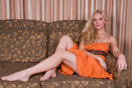 couches: Beautiful tall blonde in an orange dress