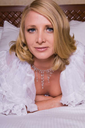 Beautiful tall mature blonde in white lingerie photo