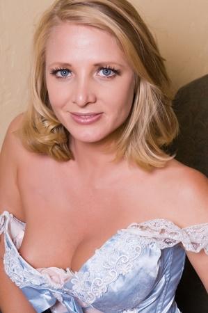 Beautiful mature blonde in a Bo-Peep dress photo