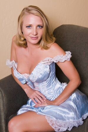 Beautiful mature blonde in a Bo-Peep dress photo