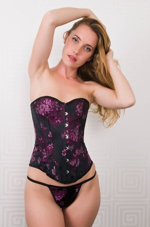 Pretty young brunette in a purple corset set photo