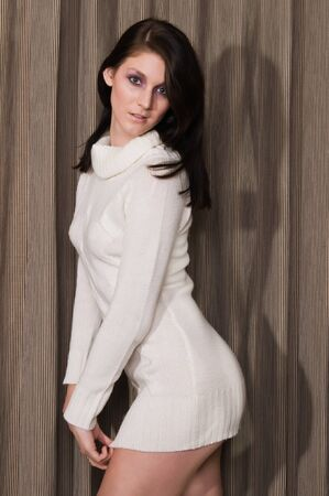 sexy sweater: Pretty young brunette in a white knit sweater