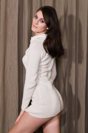 tall woman: Pretty young brunette in a white knit sweater