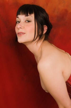 red corset: Pretty brunette dressed in a red corset Stock Photo