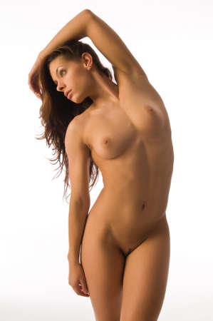 Beautiful nude athletic brunette isolated on white