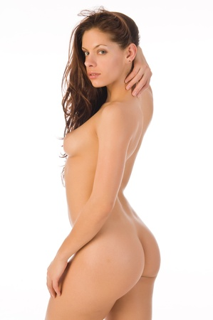 undressed young: Beautiful nude brunette against a white backdrop Stock Photo