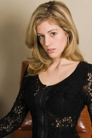 Beautiful young blonde in a black lace dress 免版税图像