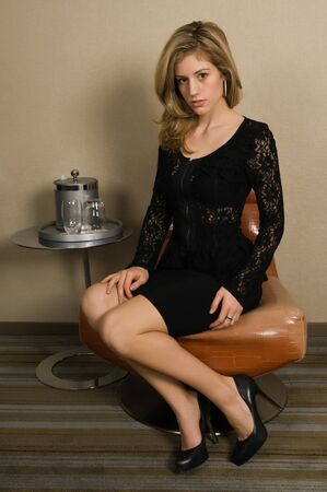Beautiful young blonde in a black lace dress Stock fotó - 8645150