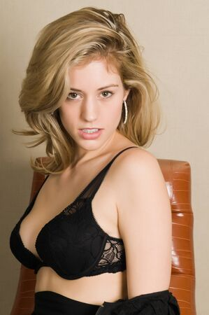 undergarment: Beautiful blonde in a black bra and skirt Stock Photo