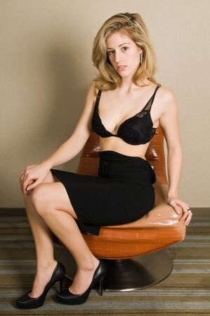 Beautiful blonde in a black bra and skirt Standard-Bild