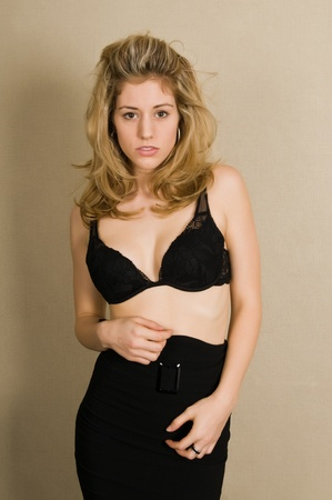 Beautiful blonde in a black bra and skirt Stock Photo - 8645192
