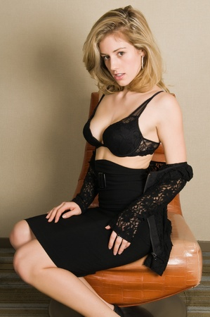 brassiere: Beautiful blonde in a black bra and skirt Stock Photo