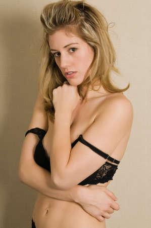 Beautiful blonde dressed in a black bra and panties photo