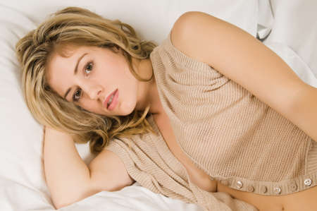 Beautiful young blonde in a beige knit blouse Stock Photo - 8683068