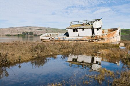 beached: Beached fishing boat on Tomales Bay, Inverness, California Stock Photo