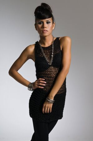 Beautiful multiracial woman in a black mesh top