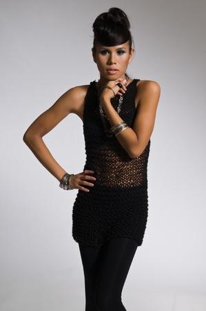 Beautiful multiracial woman in a black mesh top photo